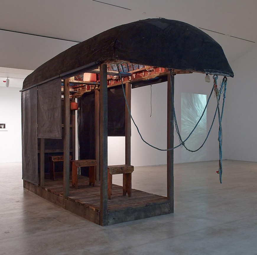 Dorothy Cross /Tabernacle, 2013 / Currach, shed, wood, roller blinds, mixed media, video / 270 x 522 x 126 cm / Collection Irish Museum of Modern Art / Donation, 2015 / IMMA.3881 | IMMA Collection: Coast-lines | Friday 13 October 2017 – September 2018 | Irish Museum of Modern Art